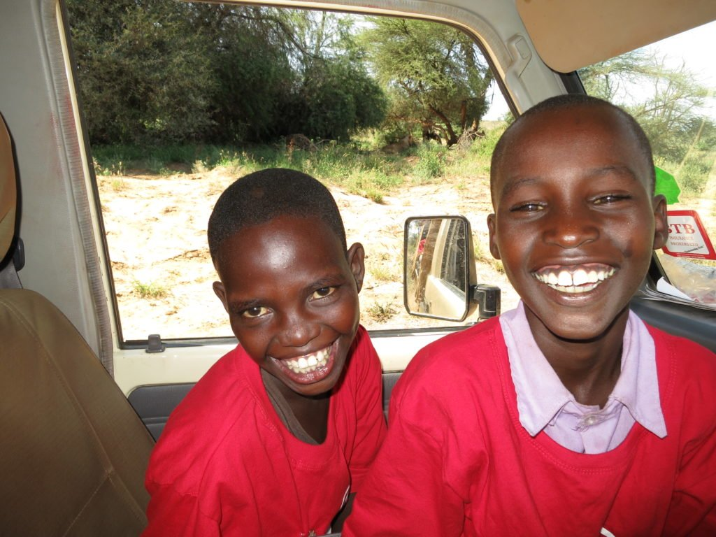 Happy kids on a game drive. Credit: Ewaso Lions
